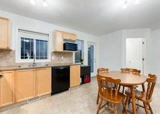 Photo 14: 218 950 ARBOUR LAKE Road NW in Calgary: Arbour Lake Row/Townhouse for sale : MLS®# A1136377