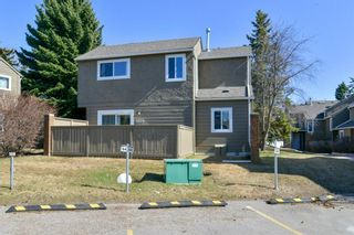 Photo 3: 1301 829 Coach Bluff Crescent in Calgary: Coach Hill Row/Townhouse for sale : MLS®# A1094909