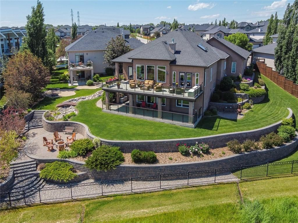 5 stunning curved retaining walls and 2 sets of steps taking you to each level of this property.  Manicured lawns and thoughtfully presented gardens and resting areas throughout this property.  Mature perennials, shrubs and trees fill this 1243 m2 yard.
