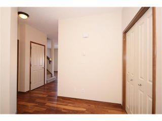 Photo 3: 103 WEST POINTE Court: Cochrane House for sale : MLS®# C4042878
