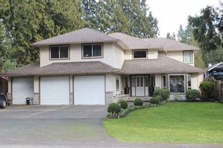 Photo 1: 4188 207 STREET in Langley: Brookswood Langley House for sale : MLS®# R2052049