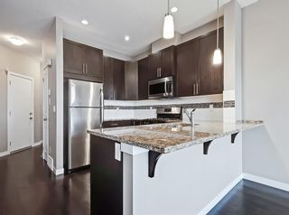 Photo 4: 2004 881 Sage Valley Boulevard NW in Calgary: Sage Hill Row/Townhouse for sale : MLS®# A1085276