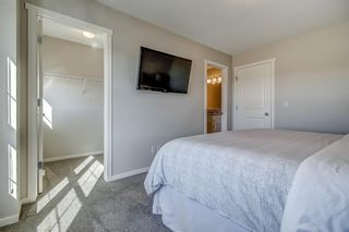 Photo 27: 100 Legacy Main Street SE in Calgary: Legacy Row/Townhouse for sale : MLS®# A1095155