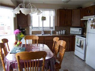 Photo 5: 561 SUMMERWOOD Place SE: Airdrie Residential Detached Single Family for sale : MLS®# C3522939