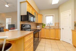 Photo 6: 101 248 SUNTERRA RIDGE Place: Cochrane Apartment for sale : MLS®# C4294936