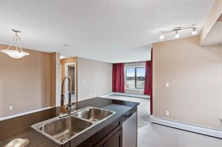 Photo 9: 7411 403 Mackenzie Way SW: Airdrie Apartment for sale : MLS®# A1152134