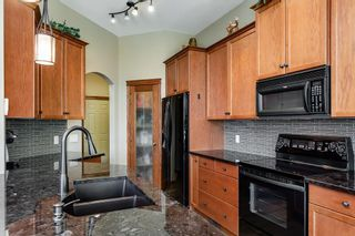 Photo 11: 825 FAIRWAYS Green NW: Airdrie Detached for sale : MLS®# C4301600