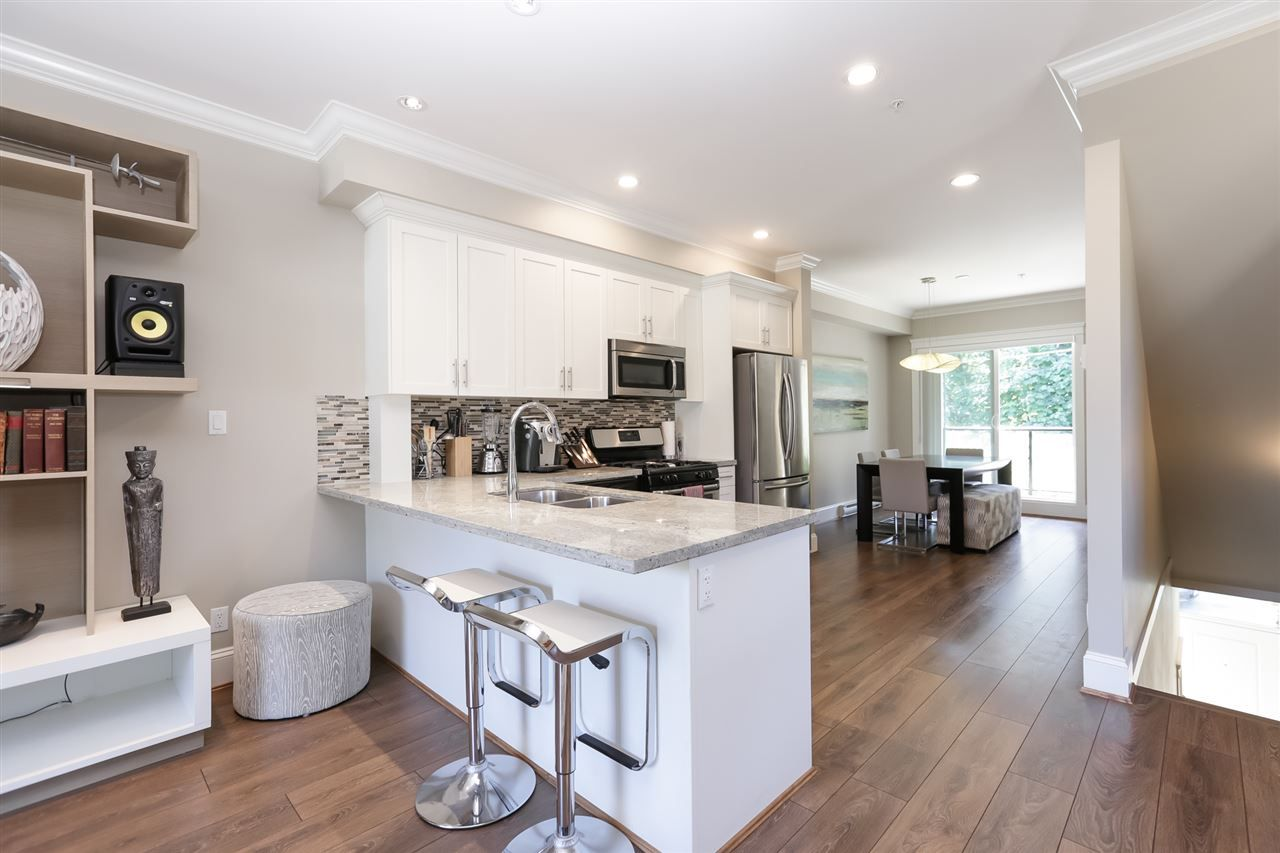"""Main Photo: 318 SEYMOUR RIVER Place in North Vancouver: Seymour NV Townhouse for sale in """"Latitudes"""" : MLS®# R2541296"""