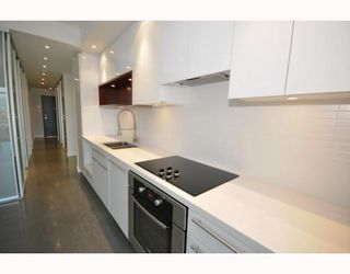 """Photo 4: 418 256 E 2ND Avenue in Vancouver: Mount Pleasant VE Condo for sale in """"JACOBSEN"""" (Vancouver East)  : MLS®# V808511"""