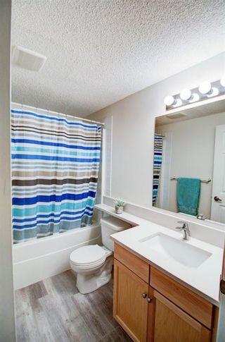Photo 18: 209 2022 CANYON MEADOWS Drive SE in Calgary: Queensland Apartment for sale : MLS®# A1028544