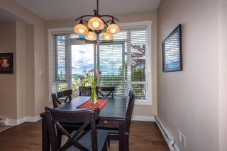 """Photo 6: 201 3600 WINDCREST Drive in North Vancouver: Roche Point Townhouse for sale in """"Windsong At Raven Woods"""" : MLS®# R2377804"""
