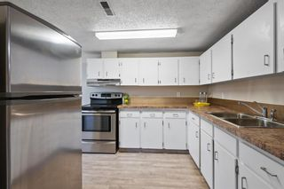 Photo 3: 101 1540 29 Street NW in Calgary: St Andrews Heights Row/Townhouse for sale : MLS®# A1108207