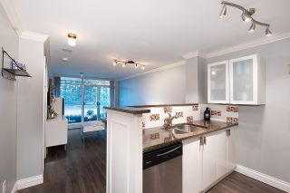 "Photo 1: 203 2763 CHANDLERY Place in Vancouver: South Marine Condo for sale in ""RIVER DANCE"" (Vancouver East)  : MLS®# R2526215"
