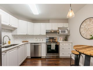 """Photo 7: 210 5977 177B Street in Surrey: Cloverdale BC Condo for sale in """"THE STETSON"""" (Cloverdale)  : MLS®# R2482496"""