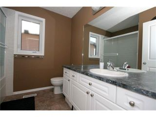 Photo 18: 52 BOW RIDGE Drive: Cochrane House for sale : MLS®# C4066881