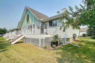 Photo 47: 20 1008 Woodside Way NW: Airdrie Row/Townhouse for sale : MLS®# A1133633
