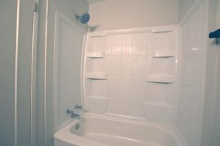 Photo 24: 77 123 Queensland Drive SE in Calgary: Queensland Row/Townhouse for sale : MLS®# A1145434