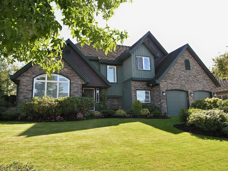 Distinctive stone,wood siding and shake exterior coupled with picture perfect landscaping provide an understated elegance to this stylish home in preferred Morgan Creek.