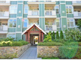 """Photo 1: 203 15350 16A Avenue in Surrey: King George Corridor Condo for sale in """"Ocean Bay Villas"""" (South Surrey White Rock)  : MLS®# F1422453"""
