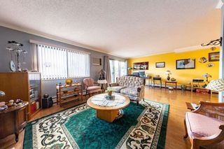 """Photo 1: 101 20420 54 Avenue in Langley: Langley City Condo for sale in """"RIDGEWOOD MANOR"""" : MLS®# R2545254"""