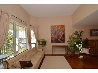 Photo 25: 148 GLENEAGLES Close: Cochrane House for sale : MLS®# C4010996