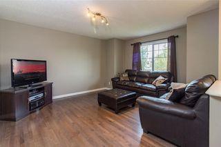 Photo 5: 306 FIRESIDE Place: Cochrane House for sale : MLS®# C4137461
