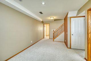 Photo 43: 12 West Hall Place: Cochrane Detached for sale : MLS®# A1119224