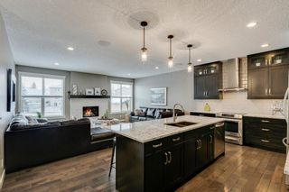 Main Photo: 648 Quarry Way SE in Calgary: Douglasdale/Glen Detached for sale : MLS®# A1067843
