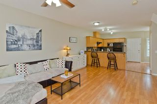 Photo 3: 205 2006 LUXSTONE Boulevard SW: Airdrie Row/Townhouse for sale : MLS®# A1010440