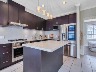 """Main Photo: 42 7171 STEVESTON Highway in Richmond: Broadmoor Townhouse for sale in """"Cassis"""" : MLS®# R2610461"""
