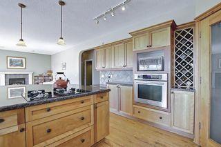 Photo 14: 60 Gleneagles Close: Cochrane Detached for sale : MLS®# A1108593