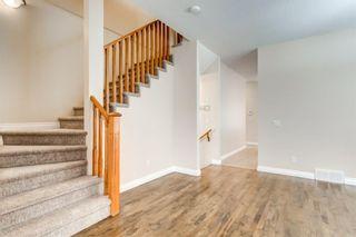 Photo 4: 4111 Garrison Boulevard SW in Calgary: Garrison Woods Row/Townhouse for sale : MLS®# A1108505