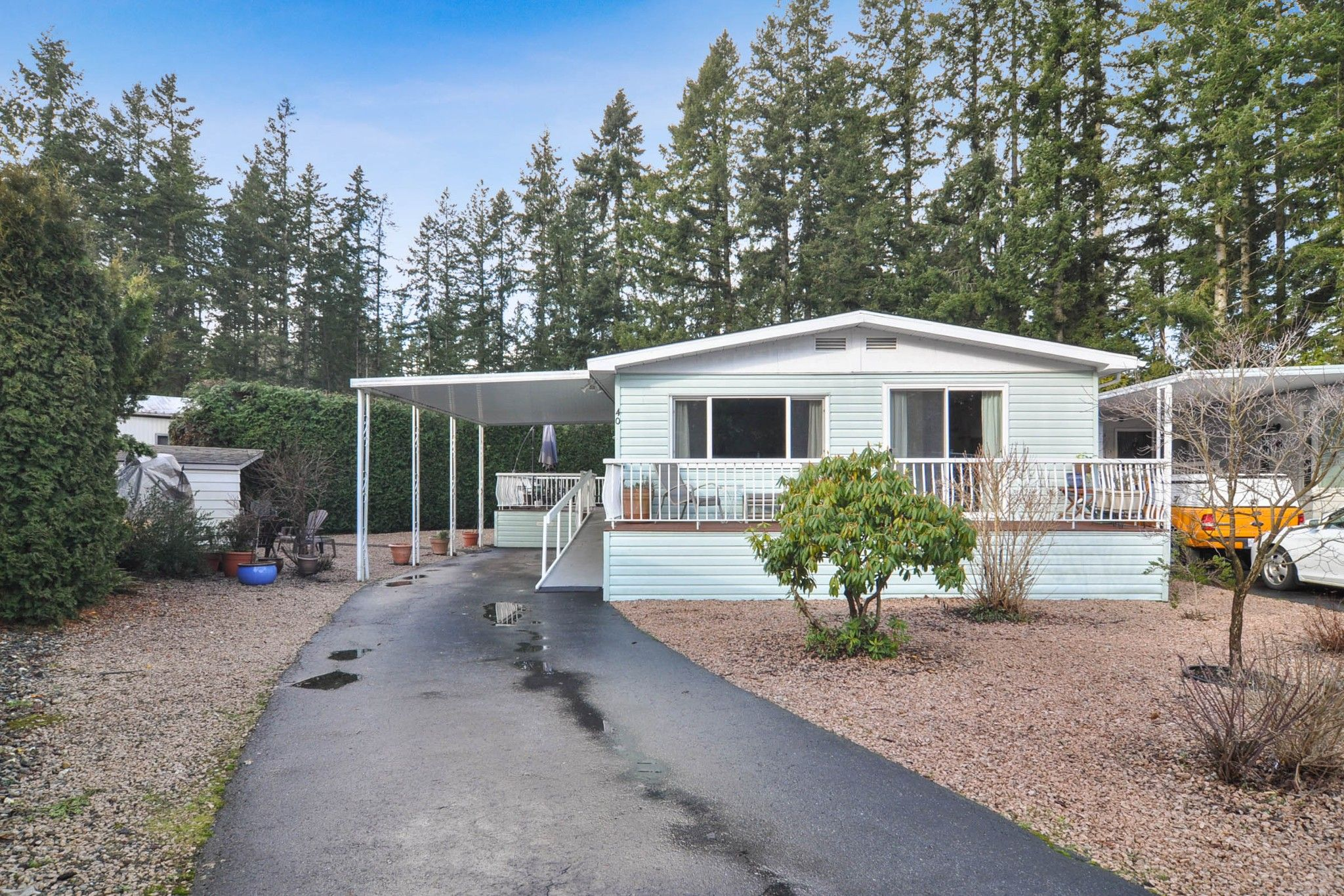 "Main Photo: 40 2305 200 Street in Langley: Brookswood Langley Manufactured Home for sale in ""Cedar Lane Park"" : MLS®# R2524495"
