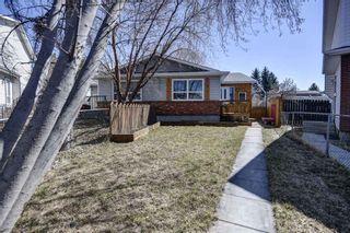 Photo 1: 187 Deerview Way SE in Calgary: Deer Ridge Semi Detached for sale : MLS®# A1096188