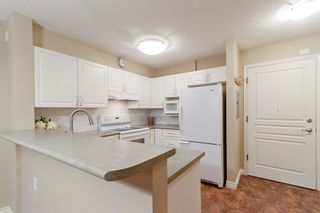 """Photo 5: 205 960 LYNN VALLEY Road in North Vancouver: Lynn Valley Condo for sale in """"Balmoral House"""" : MLS®# R2502603"""