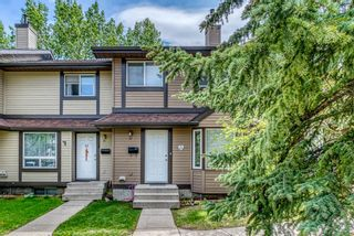 Photo 3: 37 Range Gardens NW in Calgary: Ranchlands Row/Townhouse for sale : MLS®# A1118841