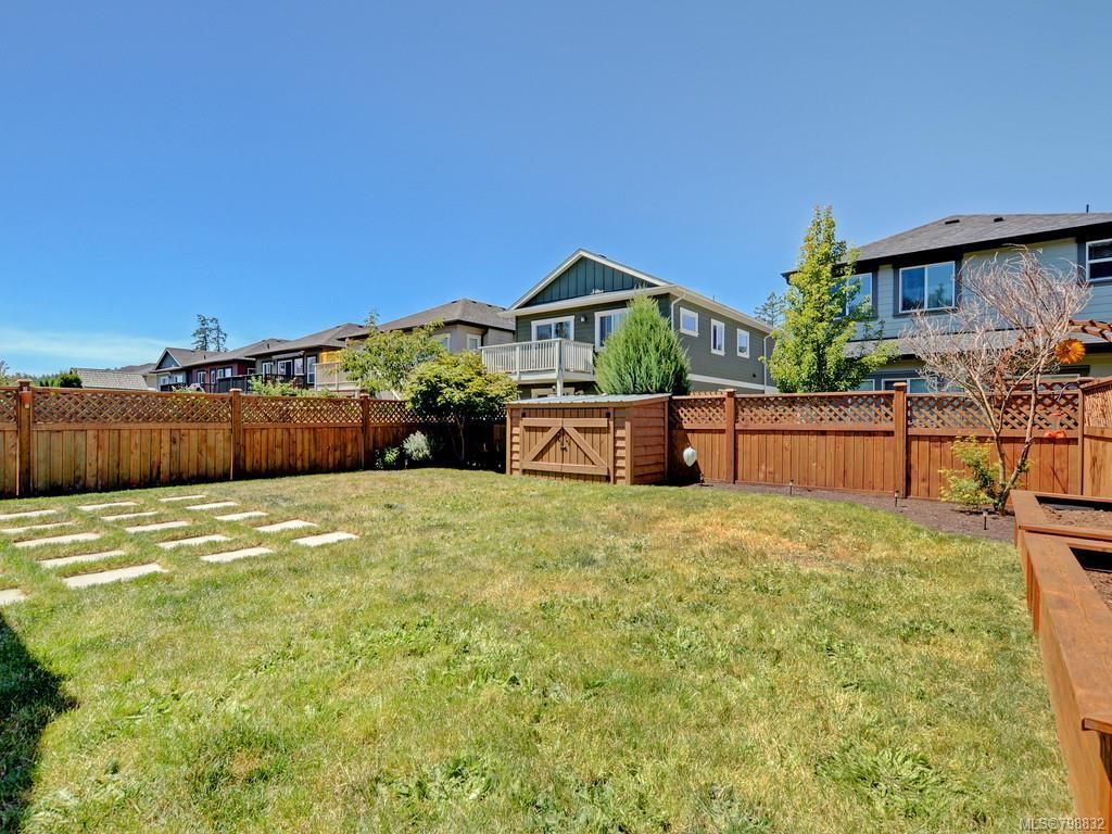 Fully fenced level back yard, larger than typical in Happy Valley in this price range!