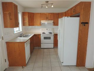 Photo 10: 350 ERIN Circle SE in Calgary: Erinwoods Residential Detached Single Family for sale : MLS®# C3644161