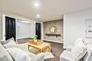 Photo 23: 143 Capri Avenue NW in Calgary: Charleswood Detached for sale : MLS®# A1143044