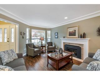 """Photo 3: 118 6109 W BOUNDARY Drive in Surrey: Panorama Ridge Townhouse for sale in """"LAKEWOOD GARDENS"""" : MLS®# R2625696"""
