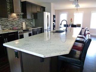 Photo 9: 3080 KESWICK Way in Edmonton: Zone 56 House Half Duplex for sale : MLS®# E4246945