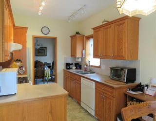 Photo 11: 24 Shannon Estates Terrace SW in Calgary: Shawnessy Row/Townhouse for sale : MLS®# A1102178
