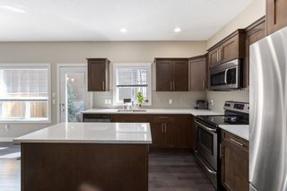 Photo 5:  in Calgary: Winston Heights/Mountview Row/Townhouse for sale : MLS®# A1105103