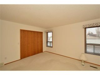 Photo 29: 12 WEST COPITHORNE Place: Cochrane House for sale : MLS®# C4049219