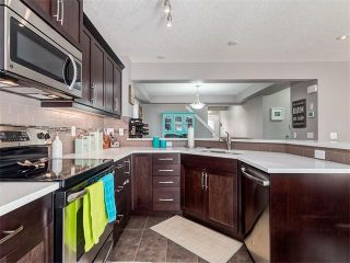 Photo 6: 18 WINDWOOD Grove SW: Airdrie House for sale : MLS®# C4082940