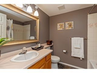 """Photo 24: 103 5641 201 Street in Langley: Langley City Townhouse for sale in """"THE HUNTINGTON"""" : MLS®# R2537246"""