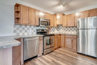 Photo 7: 704 43 Street SE in Calgary: Forest Heights Semi Detached for sale : MLS®# A1096355