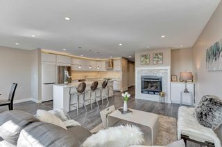 """Photo 8: 124 2721 ATLIN Place in Coquitlam: Coquitlam East Townhouse for sale in """"THE TERRACES"""" : MLS®# R2569450"""