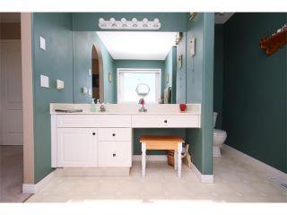 Photo 37: 51 GLENEAGLES View: Cochrane House for sale : MLS®# C4008842