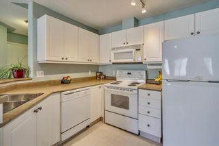Photo 12: Rocky Ridge Condo Sold By Sotheby's - Steven Hill - Certified Condominium Specialist